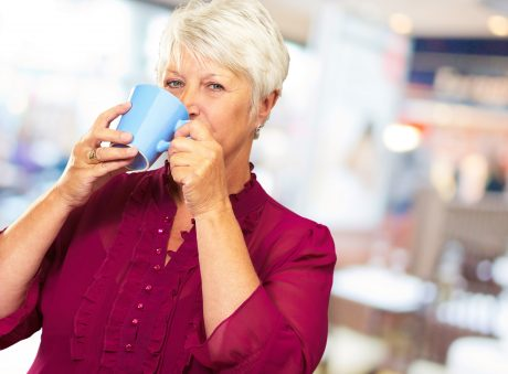 Senior Woman Drinking From Cup, Indoor